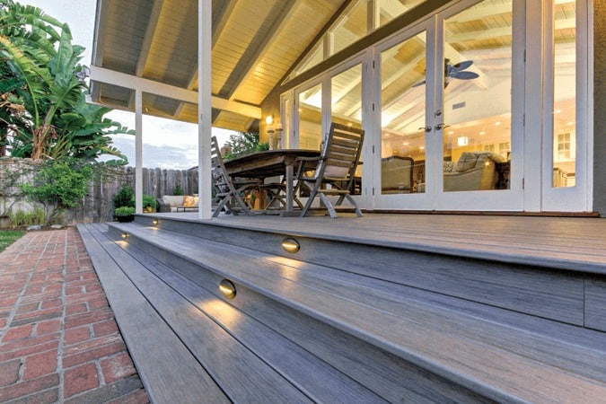 Backyard deck featuring TimberTech PRO Legacy in Ashwood with Riser Lights