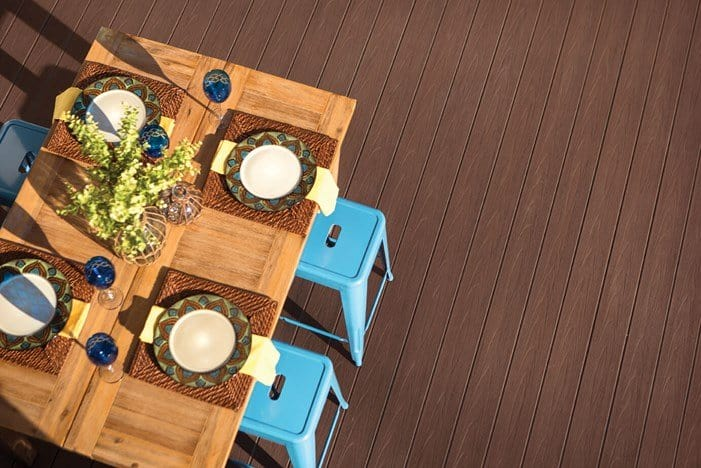 An overhead view of TimberTech EDGE Premier Collection Premier Dark Teak deck with dining table