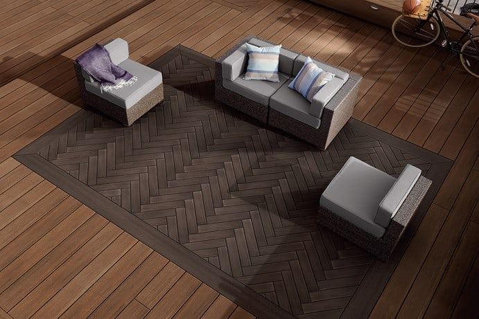 deck design ideas featuring Timbertech Vintage Collection in Mahogany herringbone pattern with outdoor furniture