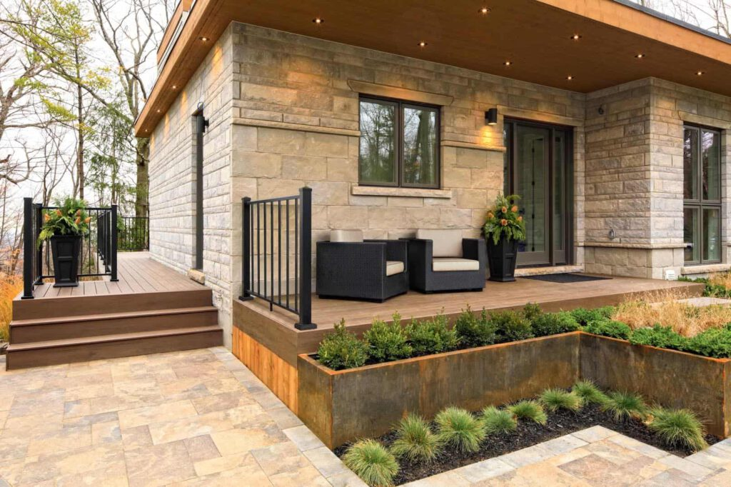 Deck featuringTimberTech PRO Legacy Collection in Espresso impression rail black with outdoor chairs