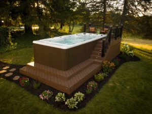 deck spa inspiration TimberTech PRO terrain in Brown Oak with rrail black and lighting