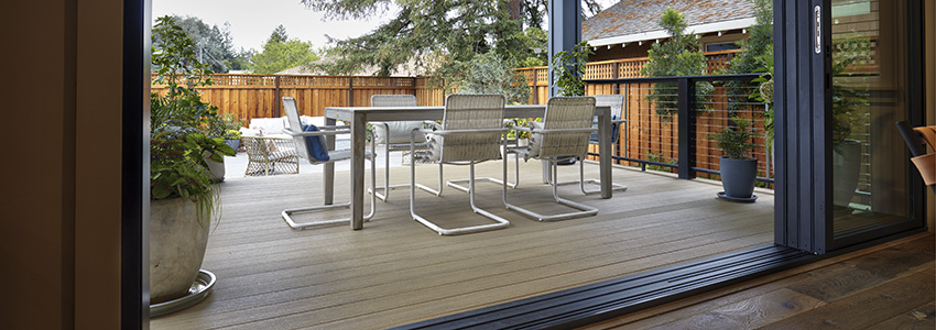 Backyard porch built rom TimberTech Porch in Weathered Teak, with industrial-chic contemporary seating
