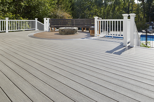 Best-Composite-Decking-For-Full-Sun-TimberTech-AZEK-Vintage-Collection-Coastline-Mahogany-Dark-Hickory-Curved-Deck-Design