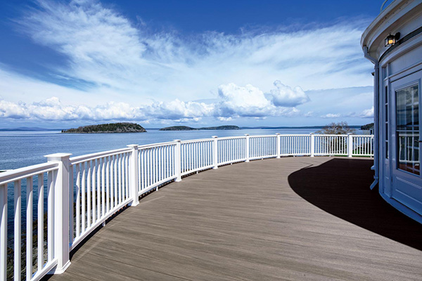 Gray composite decking TimberTech AZEK Vintage Collection Coastline curved deck with water view
