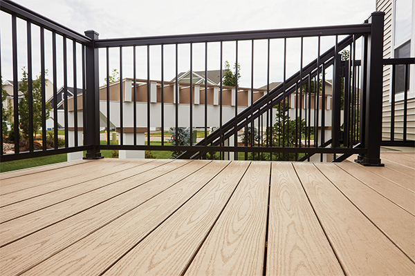 Detail view of Impresion Rail and TimberTech AZEK Harvest Collection decking in Brownstone