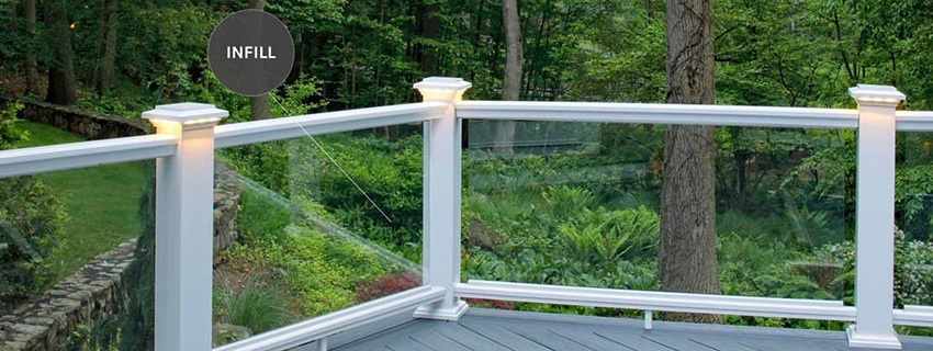 Deck railing ideas featuring composite railing and glass infill