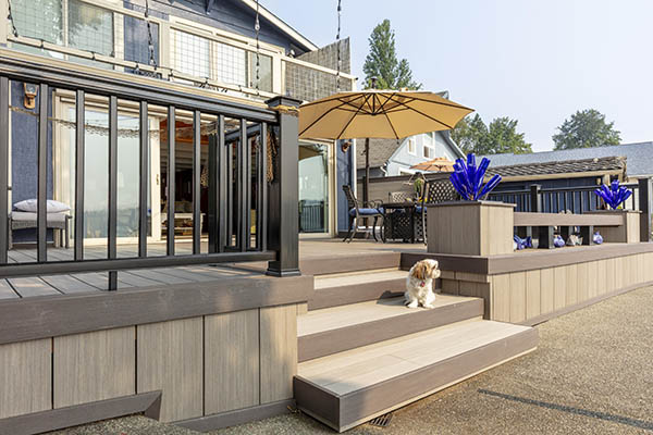 Creative Deck Ideas featuring TimberTech AZEK Vintage Collection in Coastline and Dark Hickory with dog sitting on stairs
