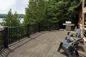 Second-story deck in the sun made from TimberTech AZEK Vintage Collection Dark Hickory