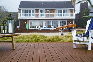 Deck featuring TimberTech AZEK Vintage Collection Mohagany with white adirondack chair