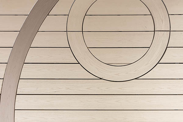 curved composite decking TimberTech AZEK Harvest Collection in Brownstone with small circle inlay