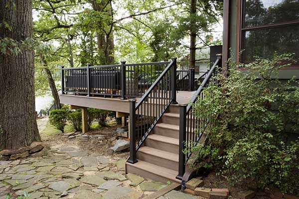 Difference Between Deck and Patio TimberTech AZEK Vintage Collection English Walnut Raised Deck in Woodlands