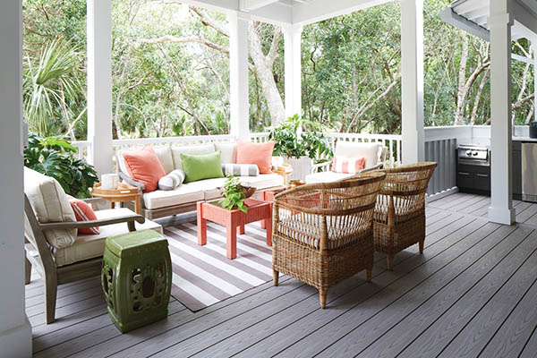 A covered composite deck with outdoor living room furniture