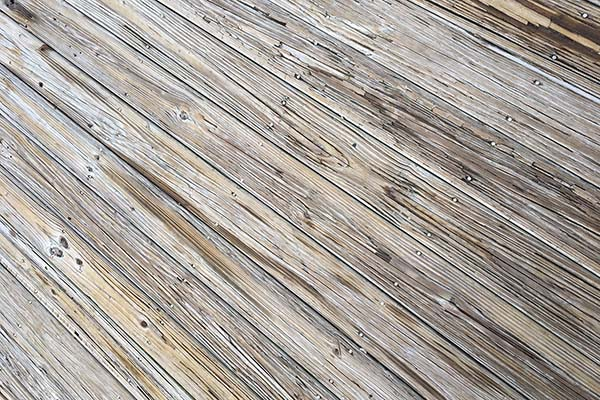 Improper deck board spacing can cause issues with wood decking