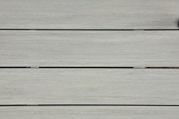 Board expansion and contraction affect deck board spacing