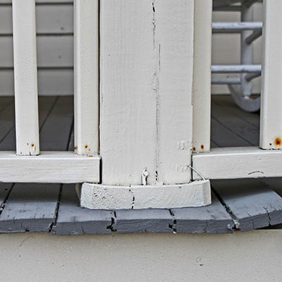 Inspect a wood deck for a loose railing