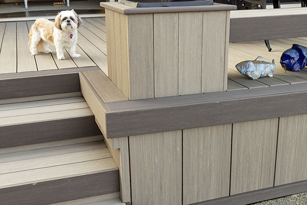 Using a deck board as fascia and a picture frame to cover decking end-cuts