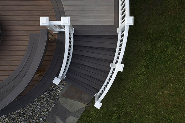 Curved, white outdoor stair railing
