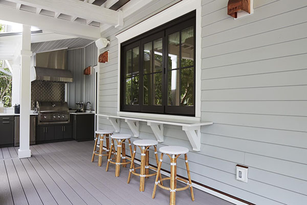 Covered deck designs featuring a built-in bar area