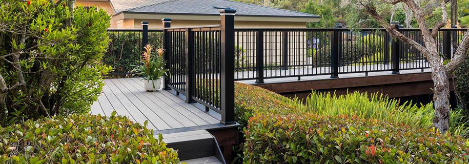 Modern deck railing ideas featuring metal railing